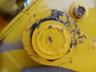 Pin seized in stick of the boom on a Komatsu Excavator